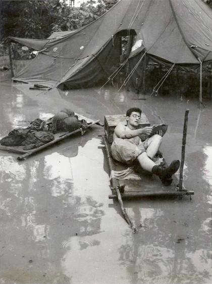 Soldier reading in the tropics